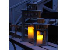 Ljus med skymningssensor på bänk med snö.