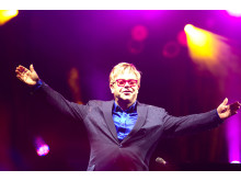 Elton John thanks the crowd at a concert for SportsAid on 28 June 2014