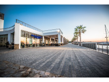 Hi-res image - Karpaz Gate Marina - The Karpaz Gate Marina promenade area features Hemingway's Resto-Bar