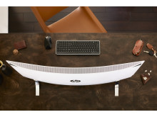 A HP ENVY Curved sitting on a desk