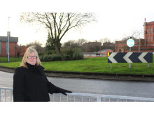 ROAD IMPROVEMENTS: Councillor June West at the Assheton Way/Oldham Road roundabout, which has been resurfaced