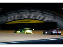 Winning GTE Pro Aston Martin Vantage under the Dunlop bridge