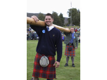 Two men carrying a caber at the Highland Games in Braemar ©Visit Britain