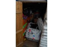 Sophie's suitcase hidden in garden shed