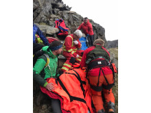Image - ACR Electronics - medics attend to the woman hiker in her thirties who fell on Crib Goch ridge