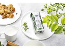 Premium-Milch von Mengniu in der 250 ml Tetra Prisma® Aseptic 250 Edge mit DreamCap™