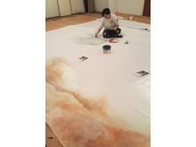 Ungdomar målar spårvagn