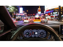 """""""Time-to-Green"""" In the Audi virtual cockpit or head-up display, drivers see whether they will reach the next light on green while traveling within the permitted speed limit"""