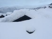 Hytte  begravet i snø