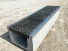 Precast concrete trench systems including Fibrelite covers