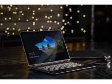 HP Spectre notebook with HP Spectre 13.3 Split Leather Sleeve and HP Bluetooth Mouse Z5000 (lights in background) HP20160325933