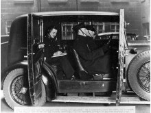 Officers in a wireless car, primed to respond to a message being sent by Morse code.