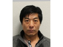 On-the-run cigarette smuggler behind bars. Shou Chen (pictured) is still at large