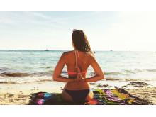 Reverse Anjali Mudra Beach Yoga_Source NOSADE