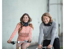 woman_man_riding_their_bikes