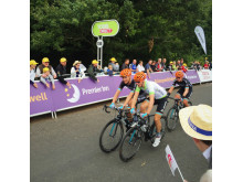 Riders coming over the finish line at Floors Castle for Stage 3 of the Tour of Britain