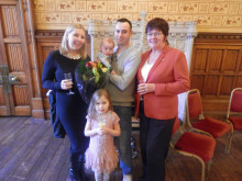 L-R: Happy couple Georgina Gray and David Turner with their children and Cllr Janet Emsley