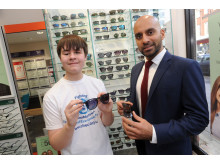 Eye cancer survivor Kelsey Trevett is guest of honour at Vision Express Ruislip. Pictured trying on frames with store director Paras Vadgama
