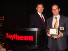 Cavotec USA's Mike Larkin and Michael Majewski receive Supplier Excellence Award from Raytheon Integrated Defense Systems