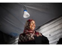 Syrian refugee, Emtyaz smiles as UNHCR staff visit her family's shelter in Azraq Refugee Camp, Al Azraq, Jordan.