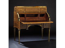 David Roentgen: A German Louis XVI gilt bronze bureau.