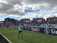 Justin Phillips of Whitecross Vets approaches the finishing line of the Simplyhealth Great North Run