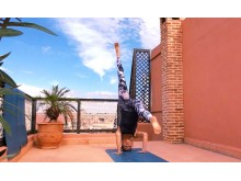 Headstand Rooftop Marrakech_Source Amanda LaMagna Livaligned
