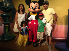Ethan, Elise and their parents Bhavna and Umesh meet Mickey Mouse whilst on vacation