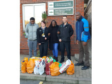 Croydon Community Food Bank volunteers Amatare Oki (far right) and Hakeem Seriki (far left) visited the Selhurst depot with Project Manager Fatima Koroma (middle)