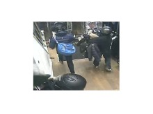 Sheraji (with blue bag) CCTV still 2