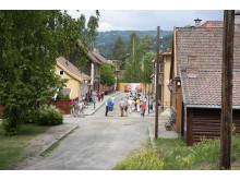Byen på Maihaugen skal utvides nordover,  slik at Storgata forlenges videre bak det gule gjerdet.