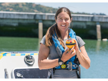Hi-res image - Ocean Signal - North Pacific solo rower Lia Ditton with her Ocean Signal SafeSea E100G EPIRB