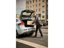 An urber delivers a package to a Volvo V40 in Stockholm, Sweden.