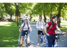 Anna, Kadir and Klara cycling in the gardens of the Royal Palace_Photo_VisitOSLO