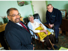 Cllr Sultan Ali, Cabinet Member for Strengthening Communities, and a local Fire Safety Officer meet with an elderly resident in Milnrow.