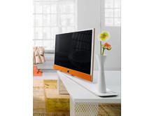 Design-tv: Loewe Connect ID med Orange kabinet og Hvid øjglans ramme.