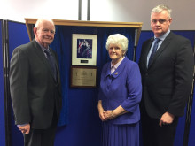 Matthew's parents and brother with memorial plaque