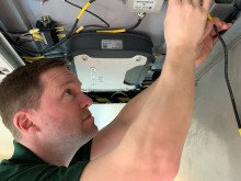 GTR Wireless engineer Robin Hayman fitting wi-fi 2