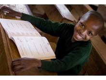 Baby Larumbe, 11 år, får utbildning tack vare ActionAid