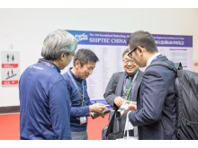 Exchanging business cards with maritime industry executives