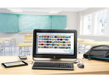 HP ProOne 400 with HP Pro Slate 10 EE and accessories in classroom with Classroom Manager on the screen