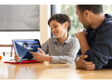 Father and son viewing an image on the HP Pavilion x360