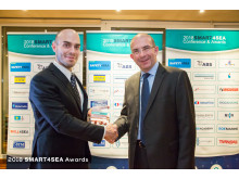Hi res image - ChartCo - From left: Antonis Souras, Ship Registrar at Palau International Ship Registry presenting ChartCo's CCO, Howard Stevens