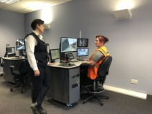 Polly McGillivray and Laura McDonald training on the sim desk
