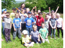 TREEMENDOUS: Judy Alderson, back, with Year 2 pupils at Holy Trinity School at a Forest School session
