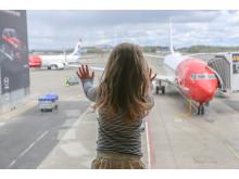 Barn på reise ved Oslo Lufthavn
