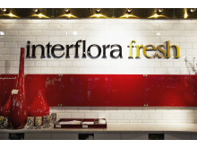 Interflora Fresh Floristkompaniet, skylt