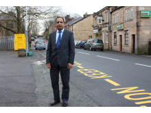 ROAD IMPROVEMENTS: Councillor Aftab Hussein on Whiteless Road in Littleborough which has been asphalted