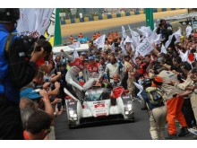The Audi R18 e-tron quattro #2 wins the 2014 Le Mans 24h with Marcel Fässler, André Lotterer, Benoît Tréluyer