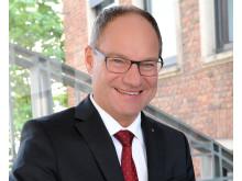 Vorstandsvorsitzender Michael Schmuck mit Hintergrund